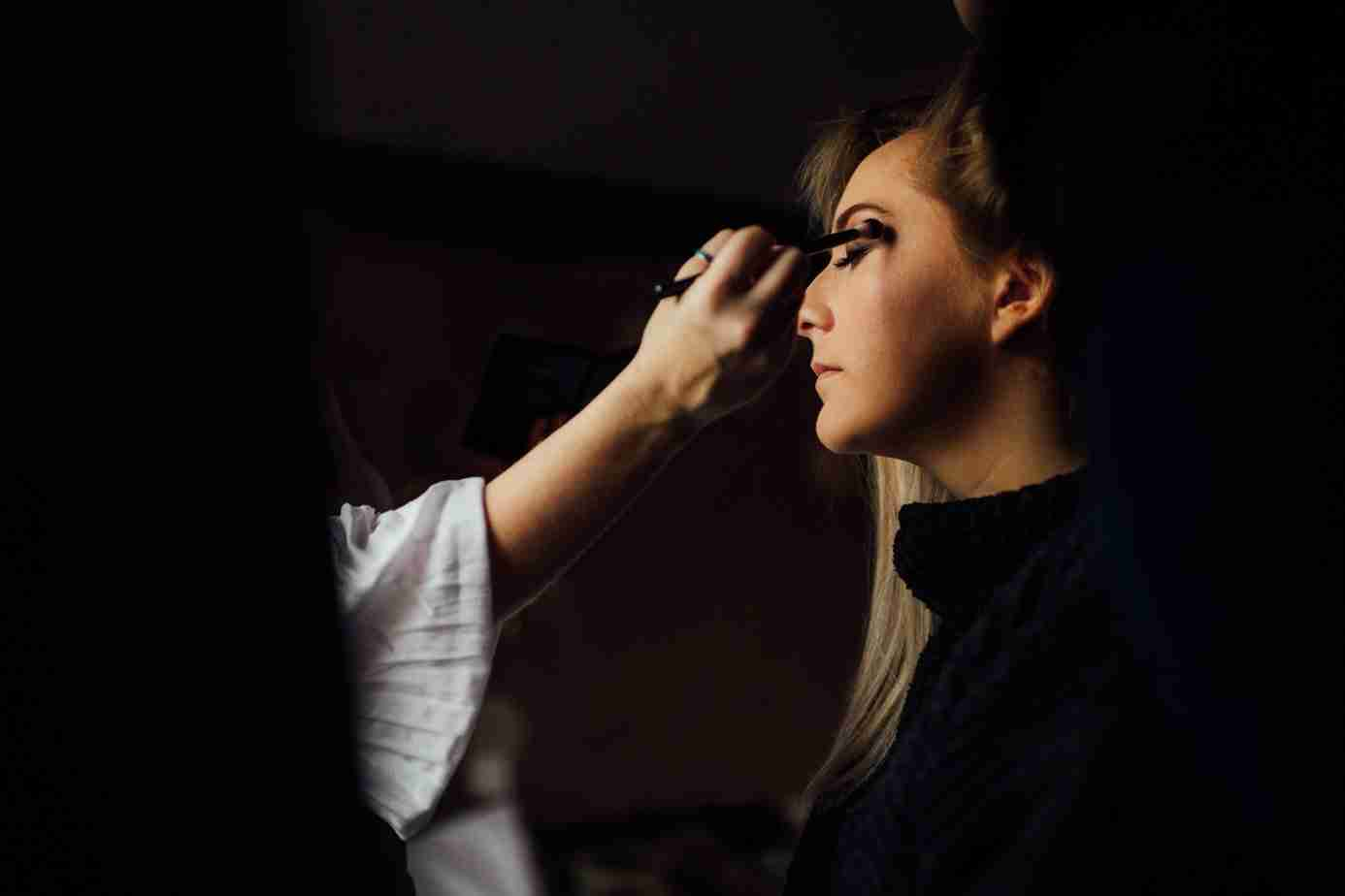 North East based MUBYLEIGH - Hair & Makeup Artist blends eyeshadow during bridal hair and makeuptrial.
